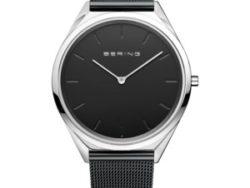 "Bering Time ""Ultra slim"" unisex ur i stål med sort meshlænke. Urskiven er sort farvet med streger som markeringer."