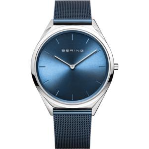 "Bering Time ""Ultra slim"" unisex ur i stål med meshlænke. Urskiven er mørkeblå med streger som markeringer."