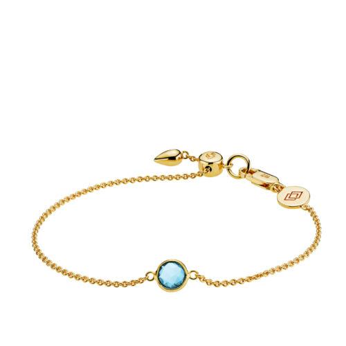 """Izabel Camille """"Prima Donna"""" armbånd i forgyldt sølv med lyseblå sten. Armbåndet kan justeres ved hjælp af glidelåsen."""