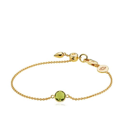 """Izabel Camille """"Prima Donna"""" armbånd i forgyldt sølv med peridot grøn syntetisk sten. Armbåndet kan justeres ved hjælp af glidelåsen."""